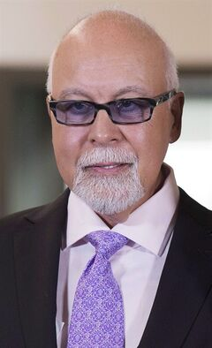 Rene Angelil is shown in Quebec City on Friday July 26, 2013. Angelil is recovering after having a cancerous tumour removed from his throat just before Christmas. He said in a statement released by his publicist Friday that the Dec. 23 operation was a success. THE CANADIAN PRESS/Jacques Boissinot