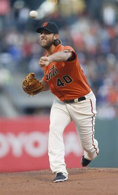 San Francisco Giants pitcher Madison Bumgarner releases the ball during the first inning of a baseball game against the Philadelphia Phillies, Friday, Aug. 15, 2014, in San Francisco. (AP Photo/Beck Diefenbach)