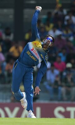 Sri Lankan bowler Sachithra Senanayake delivers a ball against South Africa during their first one-day international cricket match in Colombo, Sri Lanka, Sunday, July 6,2014. (AP Photo/Eranga Jayawardena)