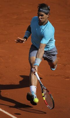 Spain's Rafael Nadal returns the ball to Britain's Andy Murray during their semifinal match of the French Open tennis tournament at the Roland Garros stadium, in Paris, France, Friday, June 6, 2014. Nadal won 6-3, 6-2, 6-1. (AP Photo/Michel Spingler)