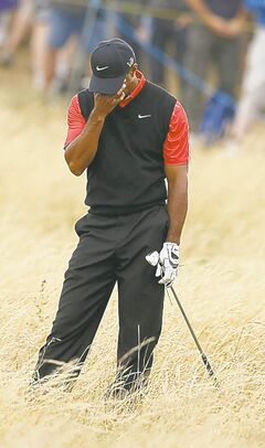This has become a familiar pose for Tiger Woods lately.