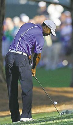 Tiger Woods hits off the 13th fairway during a practice round for the Masters golf tournament Wednesday, April 10, 2013, in Augusta, Ga. (AP Photo/Darron Cummings)