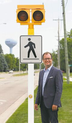 Steinbach Mayor Chris Goertzen with a new, cost-saving solar  crosswalk.
