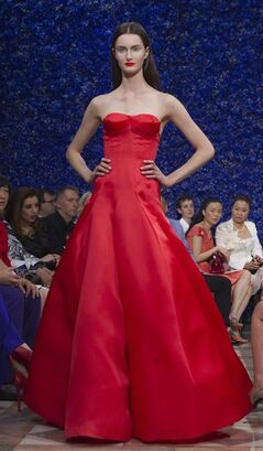 A model wears a creation by fashion designer Ralf Simons for Dior, during his Women's Fall Winter 2013 haute couture fashion collection, during fashion week in Paris, France, Monday, July 2, 2012. (AP Photo/Jacques Brinon)