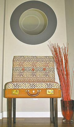 A decorative side chair made from an old suitcase is both stylish and functional.