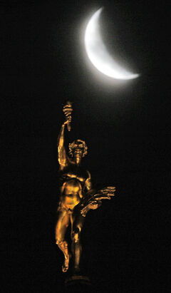 A spooky moon floats over the Golden Boy