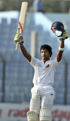 Sri Lanka's Dinesh Chandimal acknowledges the crowd after scoring a century on the fourth day of the second test cricket match against Bangladesh in Chittagong, Bangladesh, Friday, Feb. 7, 2014. (AP Photo)