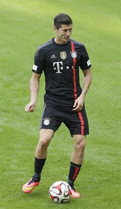 Bayern Munich's Robert Lewandowski of Poland kicks a ball during a training session after an official team presentation in the Allianz Arena stadium for the new German first division Bundesliga soccer season, in Munich, southern Germany, Saturday, Aug. 9, 2014. 65,000 spectators attended the event. (AP Photo/Matthias Schrader)