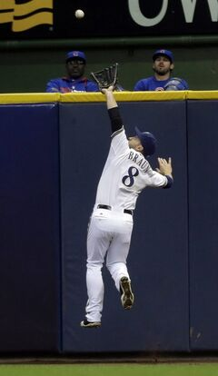 Milwaukee Brewers' Ryan Braun (8) makes a leaping catch on a ball hit by Chicago Cubs' Starlin Castro during the fourth inning of a baseball game on Saturday, April 26, 2014, in Milwaukee. (AP Photo/Jeffrey Phelps)