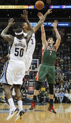 Milwaukee Bucks forward Ersan Ilyasova (7), of Turkey, shoots against Memphis Grizzlies forwards James Johnson (3) and Zach Randolph (50) in the first half of an NBA basketball game on Saturday, Feb. 1, 2014, in Memphis, Tenn. (AP Photo/Lance Murphey)