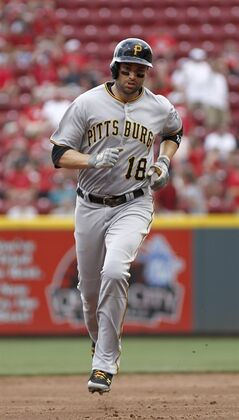 Pittsburgh Pirates' Neil Walker rounds the bases after hitting a solo home run off Cincinnati Reds starting pitcher Johnny Cueto in the sixth inning of a baseball game, Sunday, July 13, 2014, in Cincinnati. (AP Photo/David Kohl)