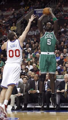 Boston Celtics' Kevin Garnett (5) shoots over Philadelphia 76ers' Spencer Hawes (00) in the first half of an NBA basketball game, Tuesday, March 5, 2013, in Philadelphia. (AP Photo/H. Rumph Jr)