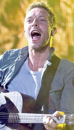 Chris Martin of English alternative rock band Coldplay performs during the Rock in Rio music festival in Rio de Janeiro, Brazil, Sunday Oct.  2, 2011. (AP Photo/Felipe Dana)