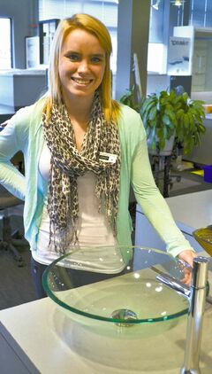 Ashley Paterson of Robinson Bath Centre shows a clear-glass bowl sink.