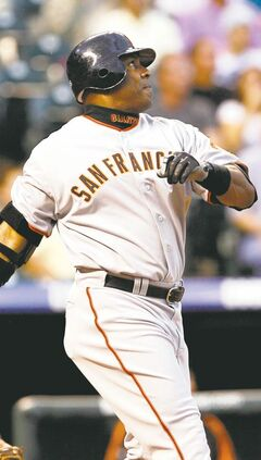 **FILE** San Francisco Giants' Barry Bonds follows the flight of his two-run home run against the Colorado Rockies in the first inning of a baseball game in Denver in this Sept. 5, 2007 file photo. Bonds filed for free agency Monday, Oct. 29, 2007, on the first possible day after the World Series ended with Boston's sweep of the Colorado Rockies on Sunday night.  (AP Photo/David Zalubowski, File)