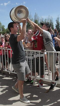 Toews lets people in the crowd lay hands on the chalice.