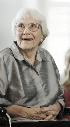 FILE -In this Aug. 20, 2007 file photo, author Harper Lee smiles during a ceremony honoring the four new members of the Alabama Academy of Honor at the Capitol in Montgomery, Ala.