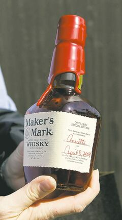 Ed Reinke / The Associated Press Archives An average bottle of Maker's Mark bourbon takes more than six years to make.