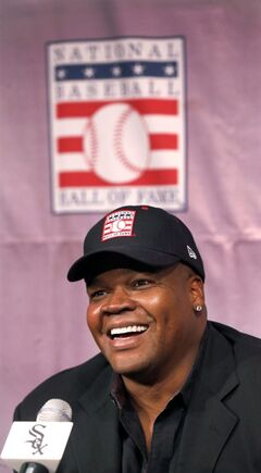 Chicago White Sox slugger Frank Thomas smiles as he responds to a question during a news conference about his selection into the MLB Baseball Hall Of Fame Wednesday, Jan. 8, 2014, at U.S. Cellular Field in Chicago. Thomas joins Greg Maddux and Tom Glavine as first ballot inductees Wednesday, and will be inducted in Cooperstown on July 27 along with managers Bobby Cox, Joe Torre and Tony La Russa, elected last month by the expansion-era committee. (AP Photo/Charles Rex Arbogast)