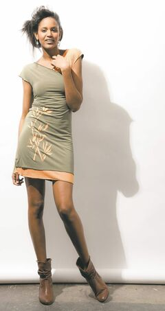 Model Yoshi wears a Tessie Dress from Voilà by Andréanne.