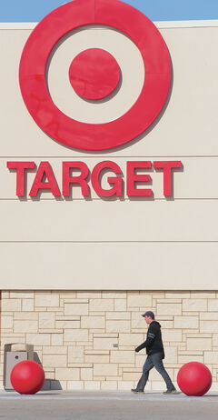 A pedestrian makes his way along the sidewalk in front of the Target store location at the Shopper's Mall.