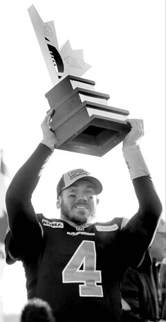 Buck Pierce hoists the East Division trophy won last Sunday in Winnipeg.