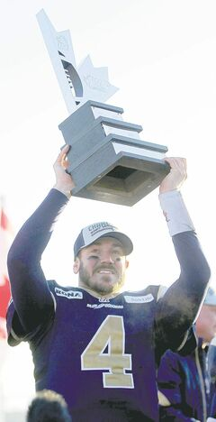 The Winnipeg Blue Bombers vs. Hamilton Tiger-Cats in the Eastern final in front of 30,051 at a Canad Inns Stadium Sunday. Quarterback Buck Pierce hoists up the cup. November 20, 2011 (BORIS MINKEVICH/ WINNIPEG FREE PRESS) close cut closecut