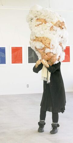 Helga Jakobson's Isafjordur, a life-size figure with its head encased in foam, wax and polyester.