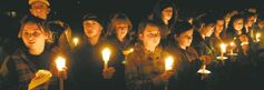 A candlelight vigil is held Jan. 15, 2010, at South Hadley, Mass., High School for Phoebe Prince, 15, who had killed herself the previous day after 'unrelenting' bullying.
