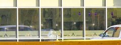 Bullet holes fill restaurant's window.
