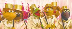 �Good� Kermit  and his  Muppet pals  belt one out;  below,  �bad� Kermit  with Tina Fey.