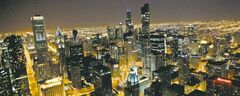 Brightly lit Chicago skyline illustrates North American  society's dependence on  abundant energy.