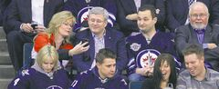 Tory MPs Shelly Glover (St. Boniface), Rod Bruinooge (Winnipeg South) and Robert Sopuck (Dauphin-Swan River-Marquette) take in a Jets game with Prime Minister Stephen Harper.
