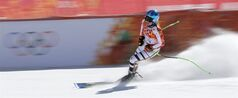 Germany's Viktoria Rebensburg arrives in the finish area at the end of a women's downhill training run for the Sochi 2014 Winter Olympics, Friday, Feb. 7, 2014, in Krasnaya Polyana, Russia. (AP Photo/Christophe Ena)