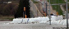 Super-sandbags keep the Assiniboine at bay at Brandon's 18th Street and Kirkcaldy Drive on Thursday.