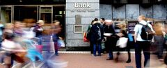 ADDS DOLLAR CONVERSION --  People wait to use the cash machine at a branch of the Allied Irish Bank in Grafton street, Dublin, Ireland, Thursday, March, 31, 2011.  The latest estimate of the cost of the Irish banking crisis is expected to be revealed later on Thursday with the release of bank stress test results. They are expected to show the banks need an extra 30 billion euros (26.3 billion pounds, 42.29 billion dollars). The Irish Central Bank has tested four lenders - Allied Irish Banks, Bank of Ireland, Educational Building Society (EBS) and the Irish Life & Permanent. The latest capital injection is expected to leave all four institutions in majority government ownership.  (AP Photo / Peter Morrison)