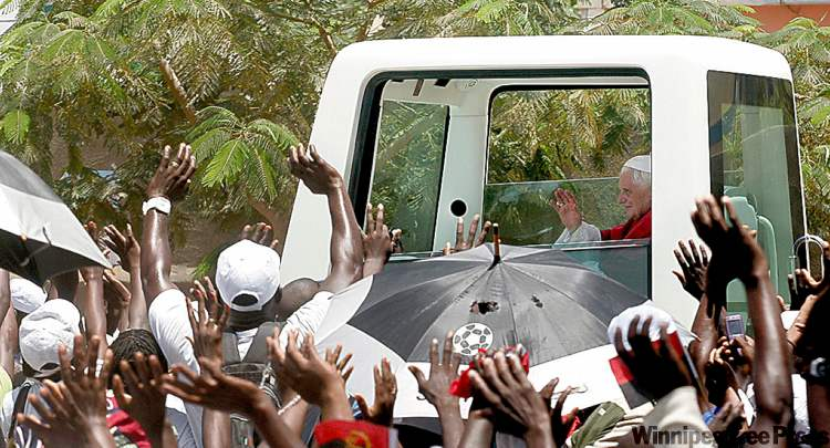 Angolans greet Pope Benedict during his seven-day pilgrimage to Africa in 2009.