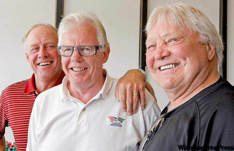 Anders Hedberg, Ulf Nilsson and Bobby Hull (from left) share a laugh on Wednesday.