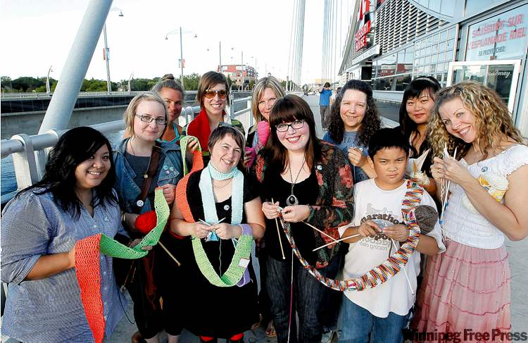 Kristin Nelson (centre left) and Jennifer Smith (centre right) have organized a posse of knitters who are planning to drape the Esplanade Riel in a 250-metre scarf.