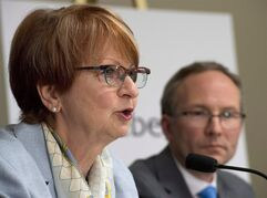 Lucienne Robillard, left, speaks at a news conference announcing her nomination as the head of a commission that will study provincial programs, Wednesday, June 11, 2014 in Quebec City. Quebec Treasury Board President Martin Coiteux looks on. Robillard says the province is living beyond its means and needs to find a way to deliver services at a lower cost. THE CANADIAN PRESS/Jacques Boissinot