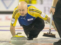 Alberta skip Kevin Koe releases a rock against Quebec in semi-final action at the Tim Hortons Brier in Kamloops, B.C., on Saturday.