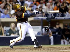 San Diego Padres' Rene Rivera drives a double to deep center against the San Francisco Giants during the sixth inning of a baseball game Saturday, Sept. 20, 2014, in San Diego. The Padres won 3-2. (AP Photo/Don Boomer)