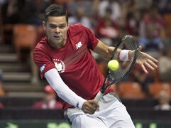 Canada's Milos Raonic returns a ball as he plays Colombia's Alejandro Gonzalez in Davis Cup action in Halifax on Friday, Sept. 12, 2014. Canada will host Japan in the first round of the 2015 Davis Cup international men's tennis tournament. THE CANADIAN PRESS/Andrew Vaughan