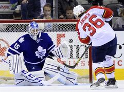 Toronto Maple Leafs goalie Jonathan Bernier makes a save against the Florida Panthers' Jussi Jokinen (36) during second period NHL action in Toronto on Thursday March 26, 2015. THE CANADIAN PRESS/Frank Gunn