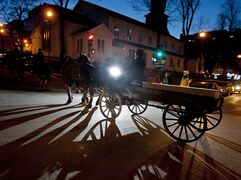 A horse-drawn carriage carries a period-style casket followed by pall bearers through the streets of Halifax to mark the 100th anniversary of the sinking of RMS Titanic on Saturday, April 14, 2011. THE CANADIAN PRESS/Andrew Vaughan