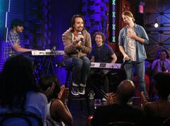 In this Aug. 5, 2014 photo released by Pivot, Tony-winning composer and writer, Lin-Manuel Miranda, seated center, performs at Pivot's Freestyle Love Supreme in New York. The group has taped 10 episodes of