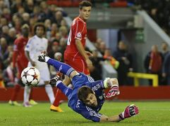 Real Madrid's goalkeeper Iker Casillas makes a save during the Champions League group B soccer match between Liverpool and Real Madrid at Anfield Stadium, Liverpool, England, Wednesday Oct. 22, 2014. (AP Photo/Jon Super)