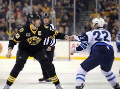 Boston Bruins defenceman Zdeno Chara (33) fights with Winnipeg Jets right winger Chris Thorburn (22) during the first period at TD Garden Saturday.