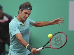 Roger Federer of Switzerland plays a semi-final tennis match against Diego Schwartzman of Argentina during the Istanbul Open tennis tournament at Garanti Koza Arena in Istanbul, Turkey, Saturday, May 2, 2015. Federer went on to win the match 2-6, 6-2, 7-5. The first ever ATP World Tour event in Turkey is being played on clay from April 27, to May 3, 2015. (AP Photo)