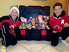 (Left) Benjamin Brigg, 11, and brother Nathan, 13, show off some of the  non-perishable food items they collected in the Domain area on Halloween as part of Feed the Children's We Scare Hunger campaign.